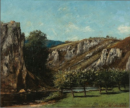 Mountainous landscape with fruit trees in Ornans.jpg